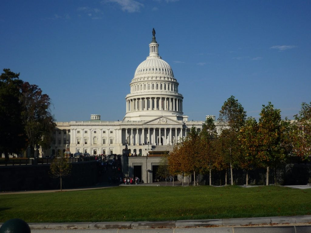 US Capitol building with white dome set against clear blue sky