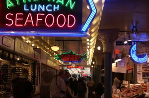 Seattle Fish market at night with neon restaurant sign
