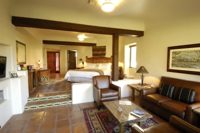 large guestroom with beamed ceiling and native designs at Tubac Golf Resort