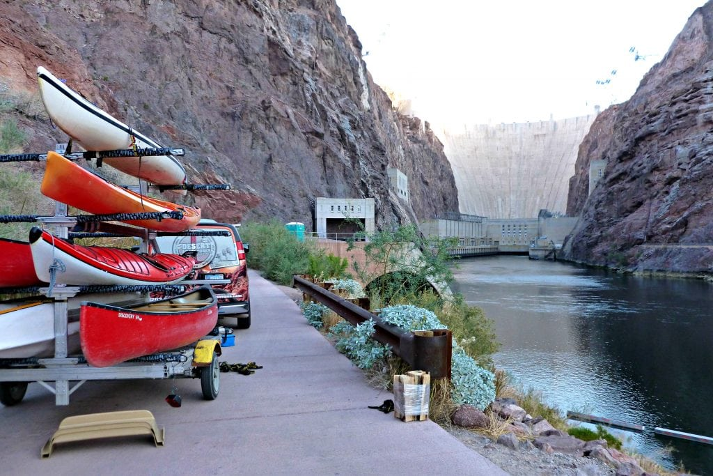 Kayaks stacked on a trailer are ready to be unloaded for Hoover Dam kayak tour