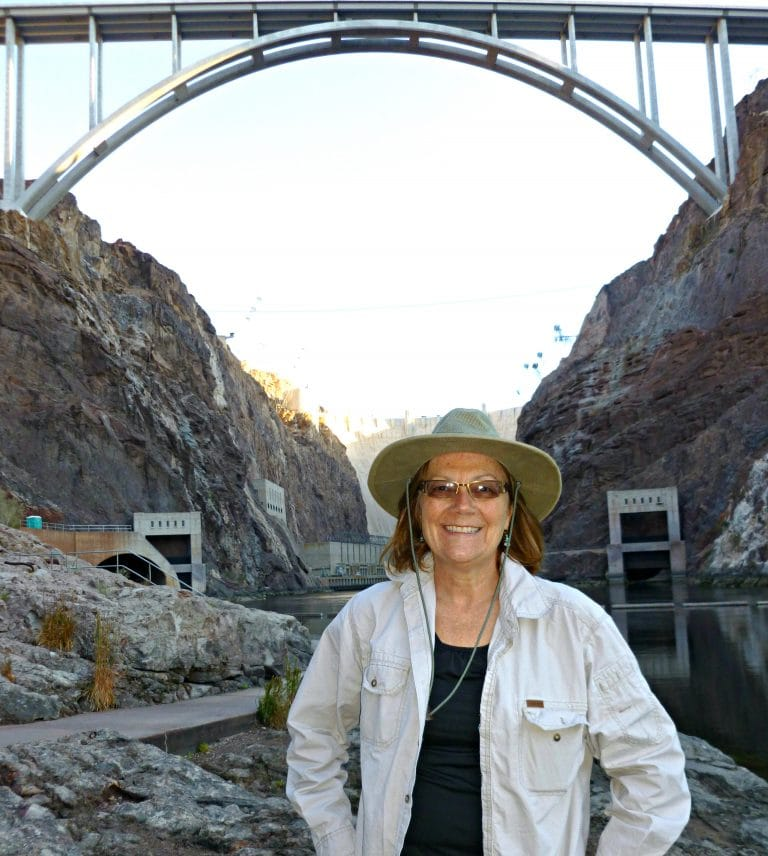 Unstoppable Stacey blocks any view of the Hoover Dam but the bridge is seen above her head