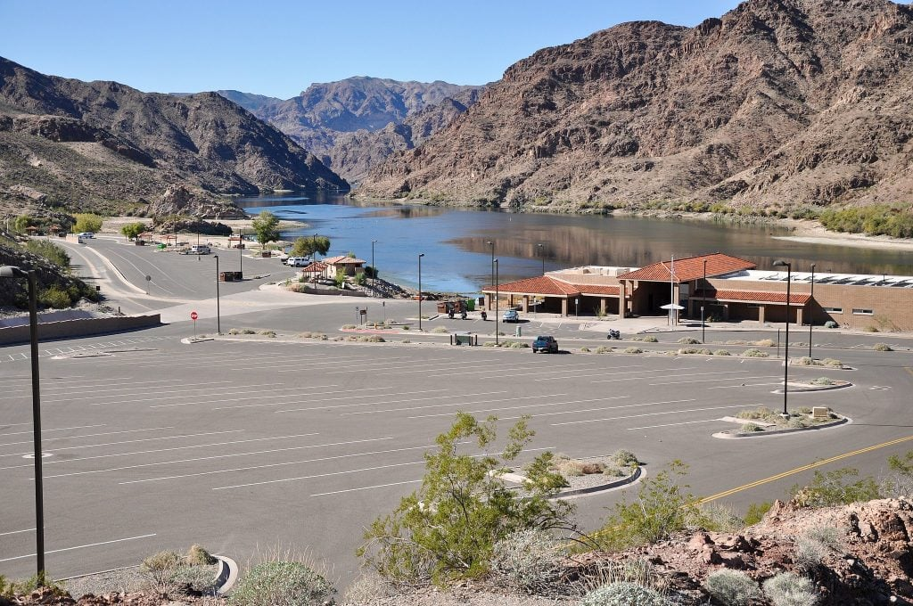 Willow Beach at Lake Mohave with red cliffs towering above