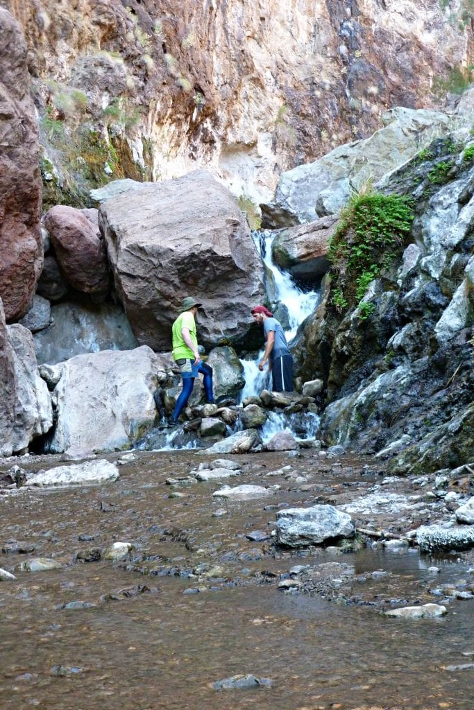 Dan and Gary walk along trails filled with hot water and approach a water fall in the Black Canyon.