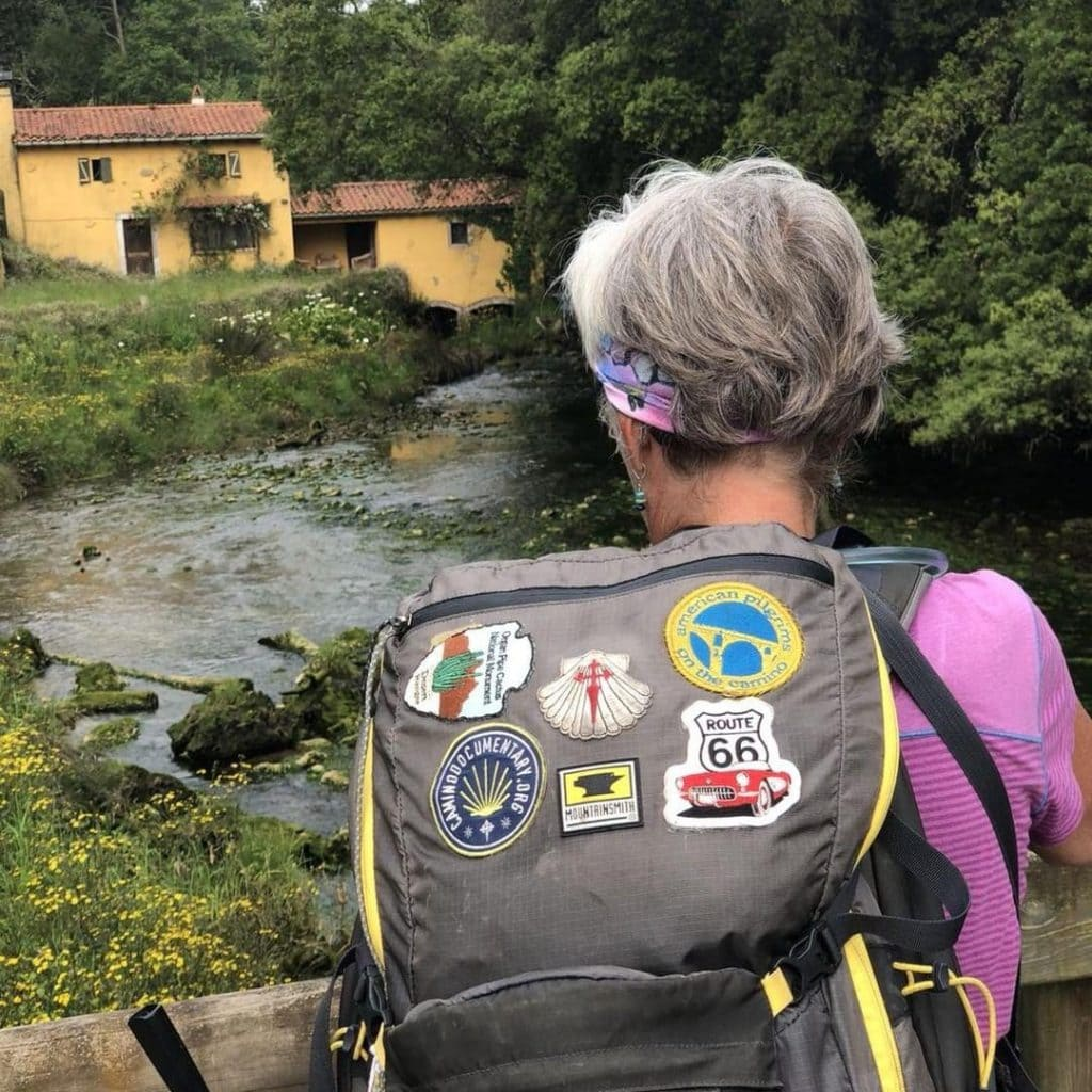Unstoppable-Stacey's pack covered with patches on the Camino