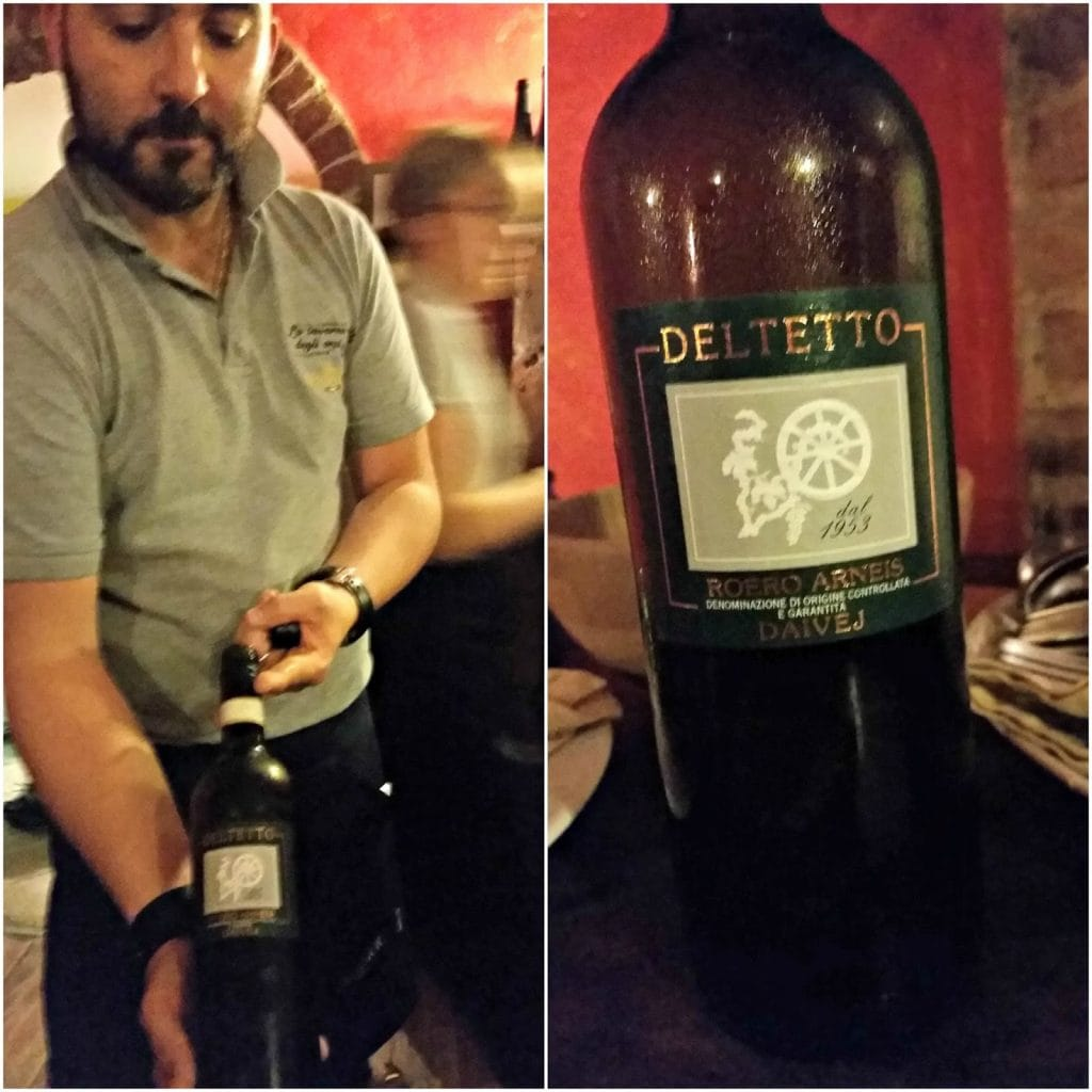Owner Prince shows wine label to camera and close up of Deltetto Winery label