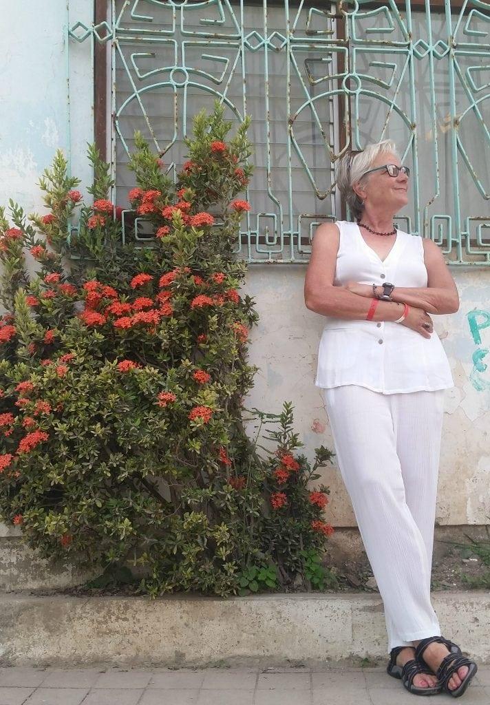 Travel writer Stacey Wittig poses next to Mazatlan architecture
