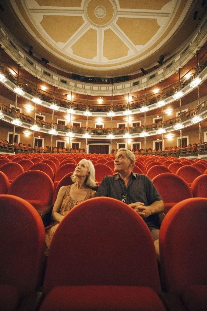 Retired couple sits in Ángela Peralta Theater, Mazatlan