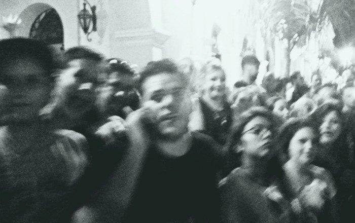 Crowd watching Dia de Los Muertos callejoneada