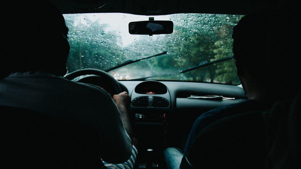 inside car looking through rainy windshield