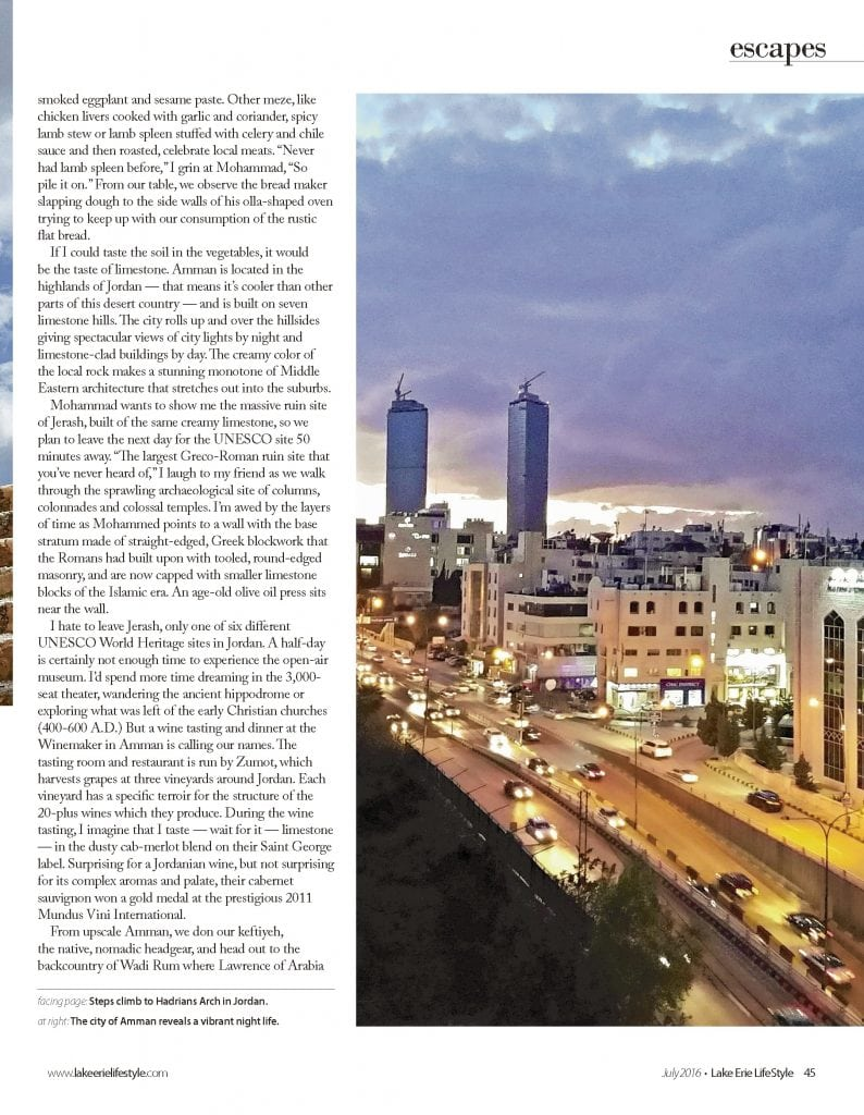 Magazine page with photo of sunset over downtown Amman