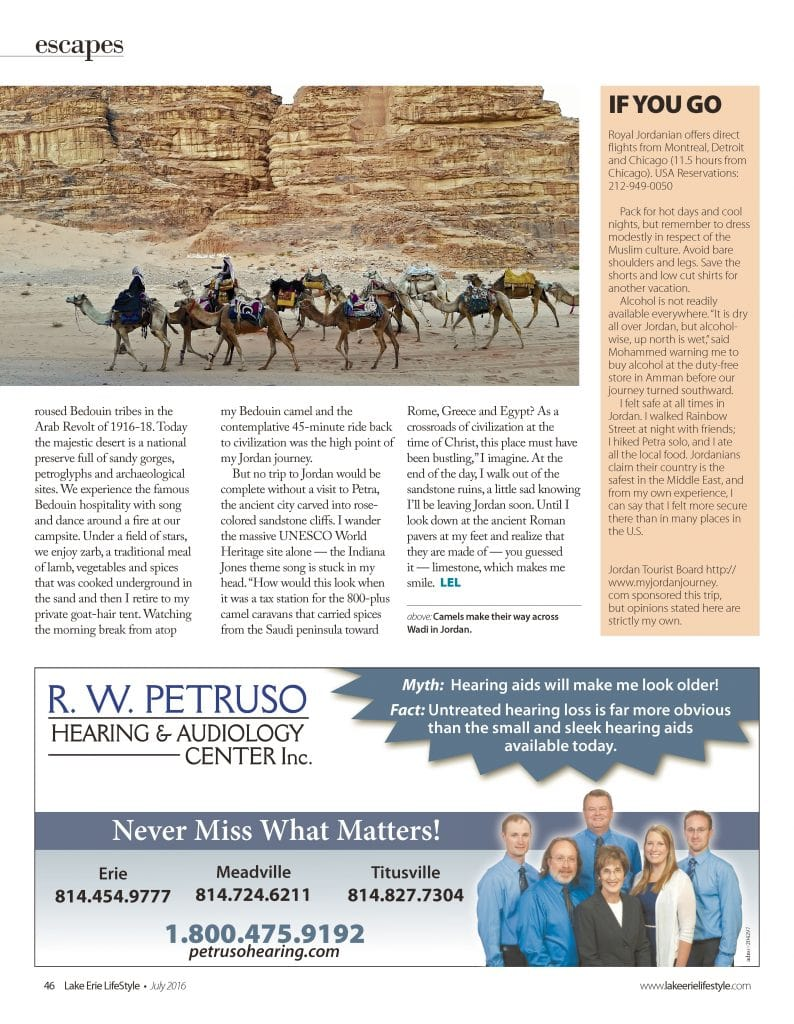 Magazine page with photo of camel caravan in Jordan desert