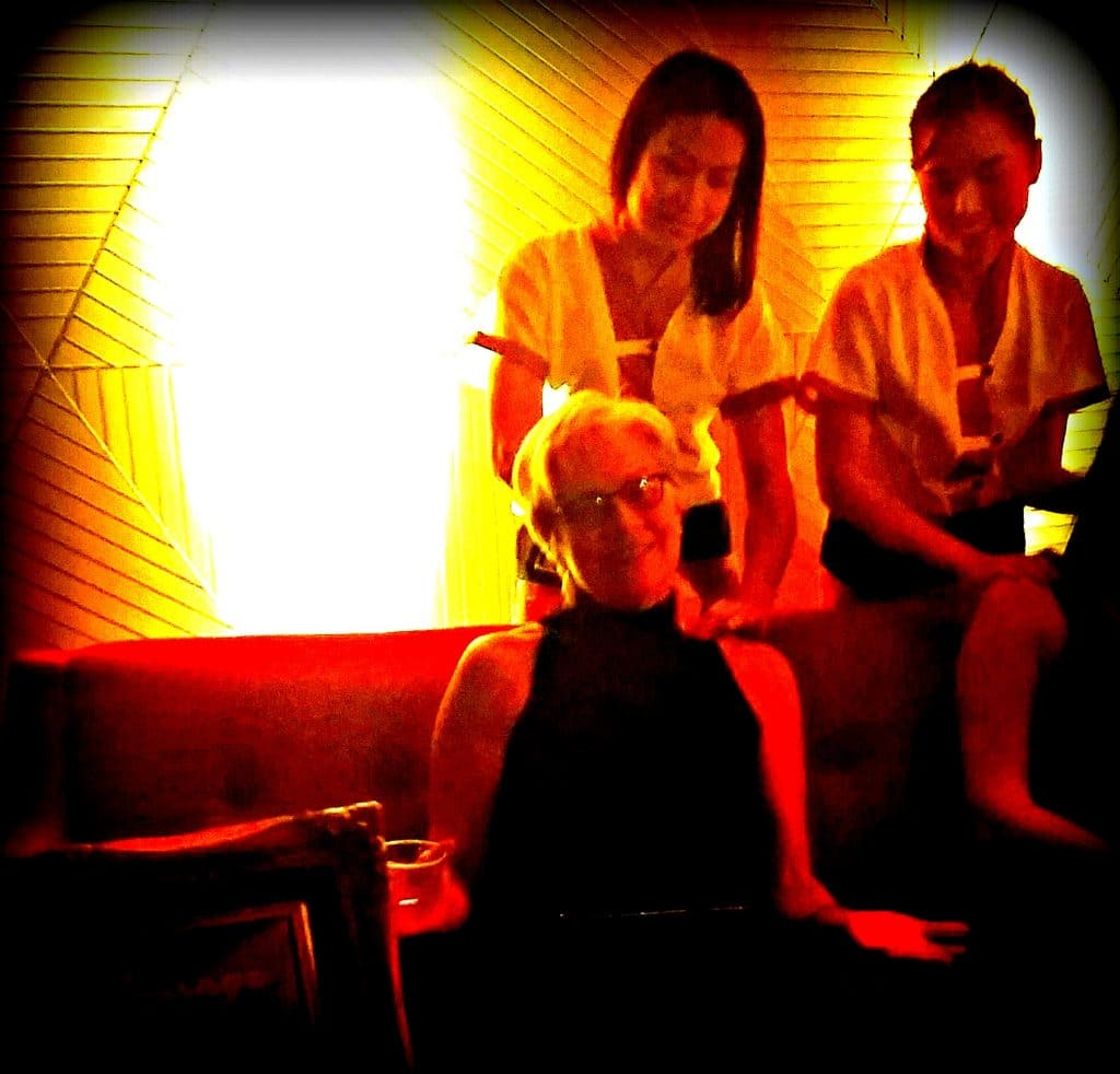 Unstoppable Stacey gets chair massage from Thai massage therapists at TAT party