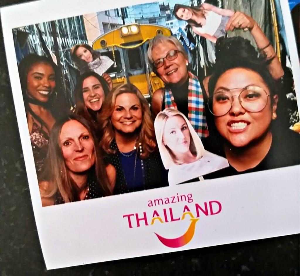 Polaroid photo of travel writers with Amazing Thailand logo