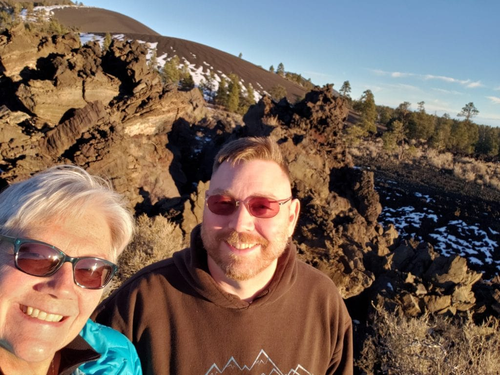 Unstoppable Stacey stands with husband Dan in front of volcanic lava field