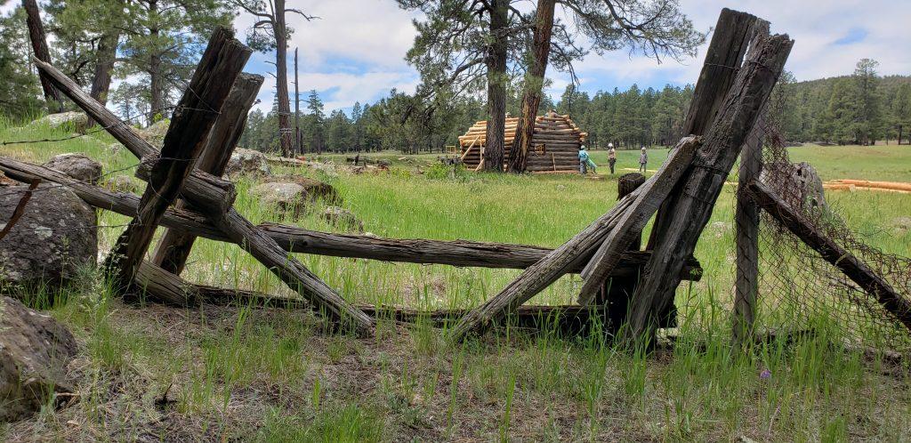 Corral gate frame Brolliar Cabin in distance