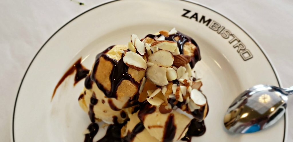 French Cream Puffs at ZAMBISTRO in Medina, NY. Vanilla Bean Ice Cream Stuffed, Chocolate Sauce, Sliced Almonds eaten at stopover on canal boat trips