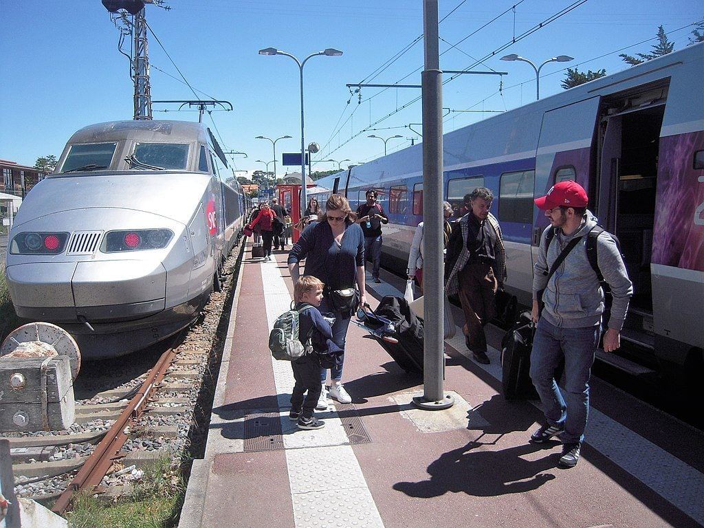 Passengers debarking in front of fast TGV train from Bordeaux at D'archon station