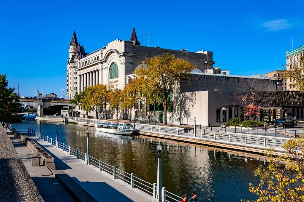 Rideau Canal with government building behind shows flat water for urban kayaking