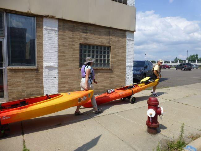 Portaging kayaks through downtown Minneapolis.