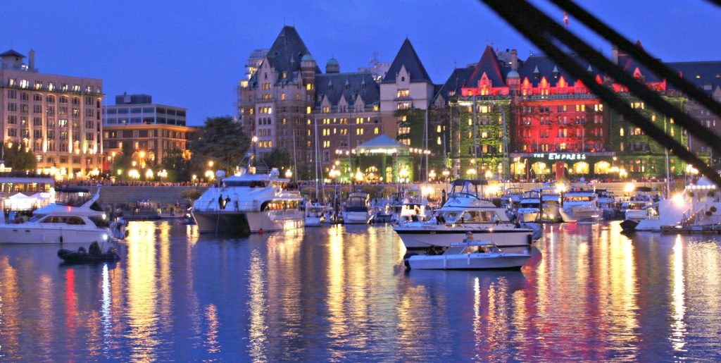 Victoria's inner harbor at night fall reflects lights from the city