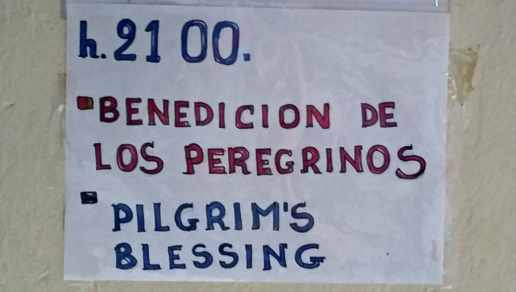 "Handmade sign reading ""Pilgrims Blessing"" in Spanish and English on Camino de Santiago"