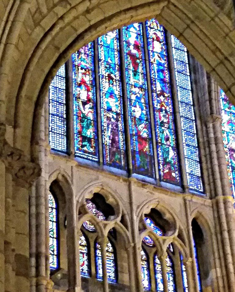 Stain glass fills a huge arched window at Leon Cathedral
