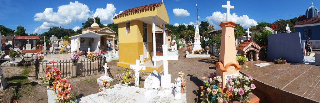 Mexican cemetery with brightly painted small mausoleums