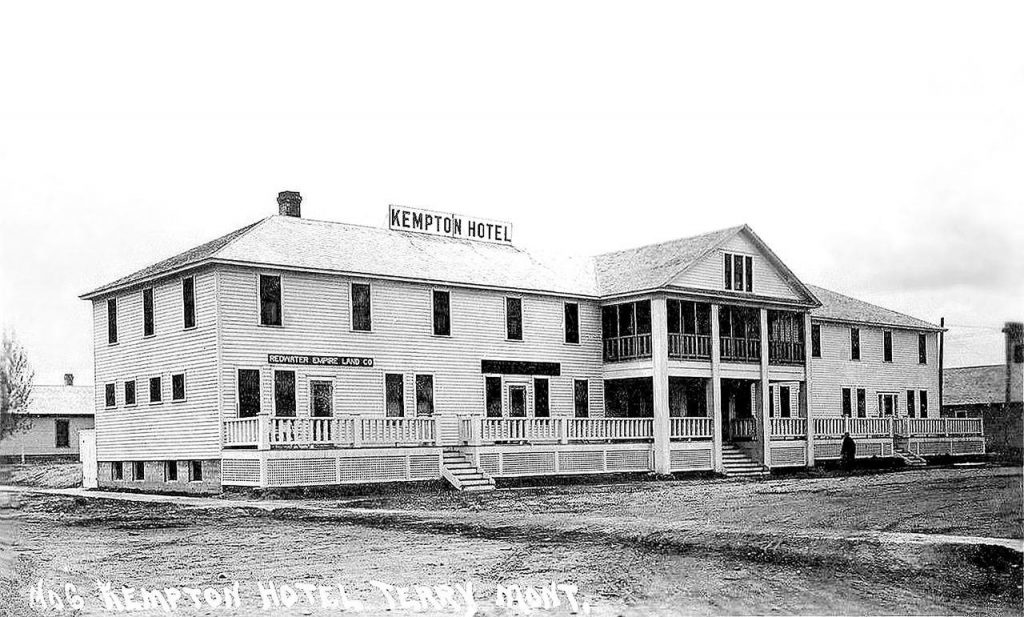 The two-story Kempton Hotel looks to be 1 block long in this turn-of-the-century photo.