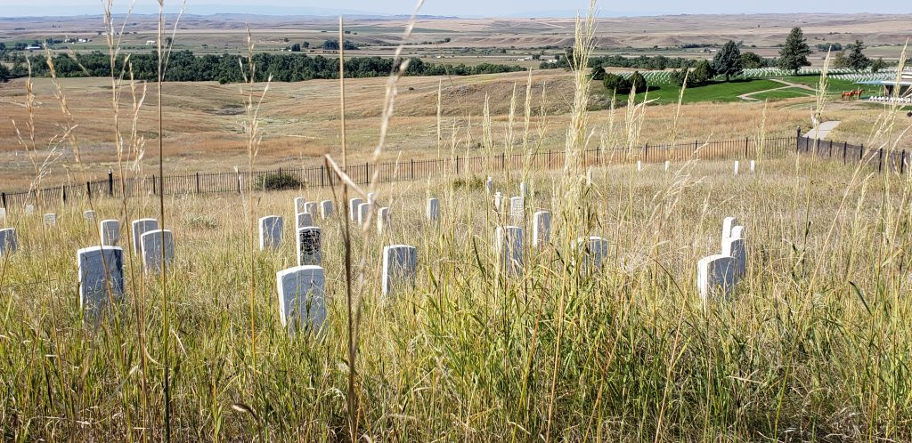 White grave markers mark the place where a soldier died on theis true west prairie battlefield.