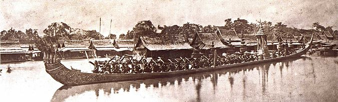 Sepia tone photo from 1865 showing Thai royal barge processional on river