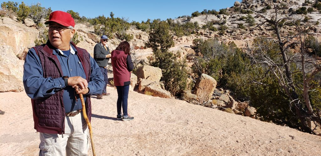 Elmer Torres leads hikers on wide trail