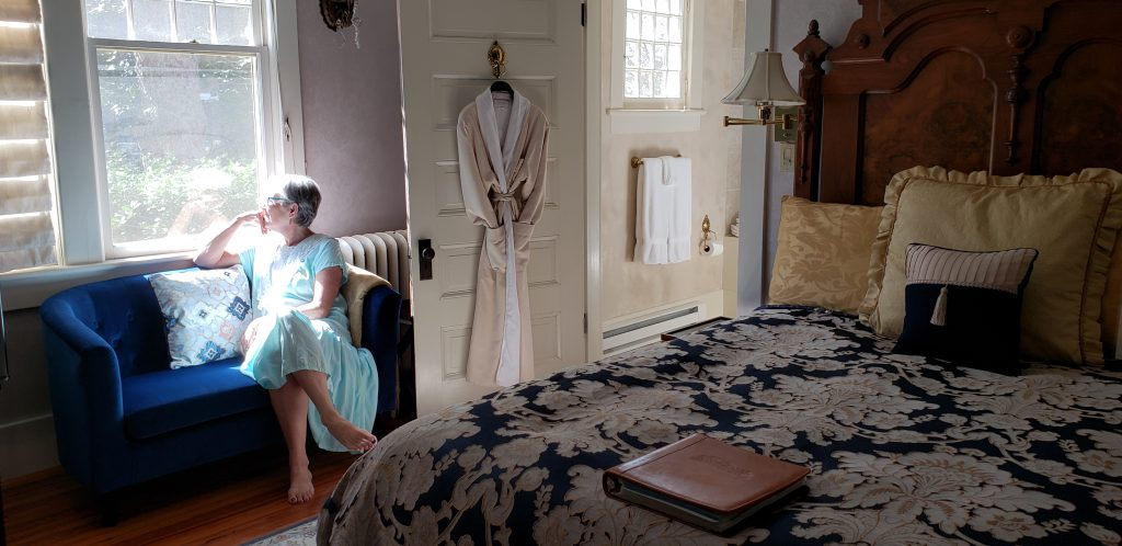 Travel blogger Unstoppable Stacey contemplates life as a Vanderbilt while looking out the bedroom window at Cumberland Falls bed and Breakfast.