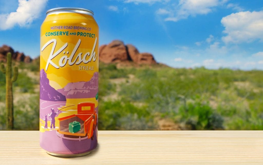 Tall beer can with Flagstaff craft beer labeling superimposed over photo of scenic hiking area