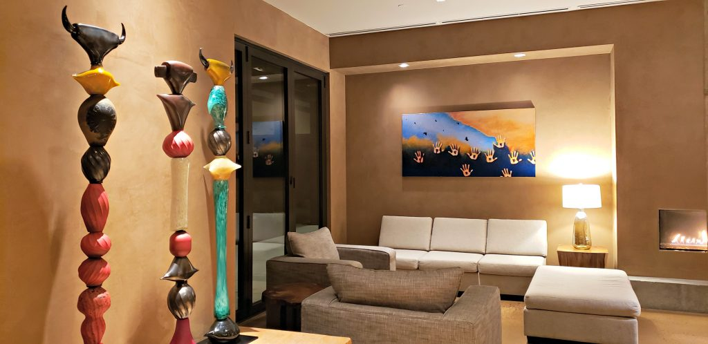 Hotel lobby with white sofa and modern native art sculptures