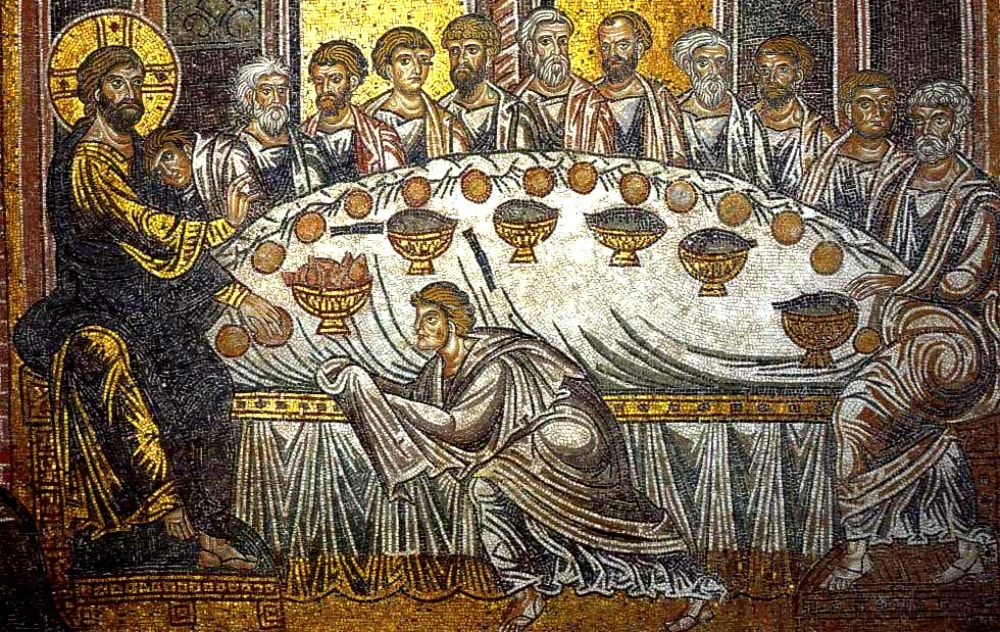 In early Christian art people look one dimensional. This mosaic shows Jesus on the left of a table set for dinner with bread - that looks like round circles (no dimension) and fish in one of 6 bowls on the table. I cannot tell what is in the other 5 golden bowls, but it is black and tubular. Eels?