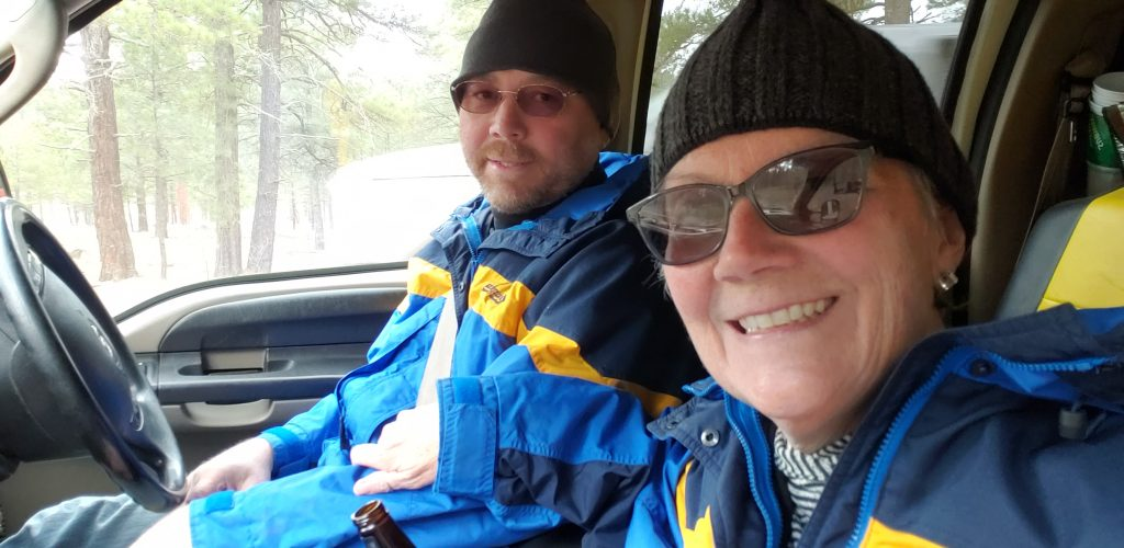 Unstoppable stacey and husband Dan wear matching winter expedition coats. How to Plan a Virtual Vacation: Dress the part