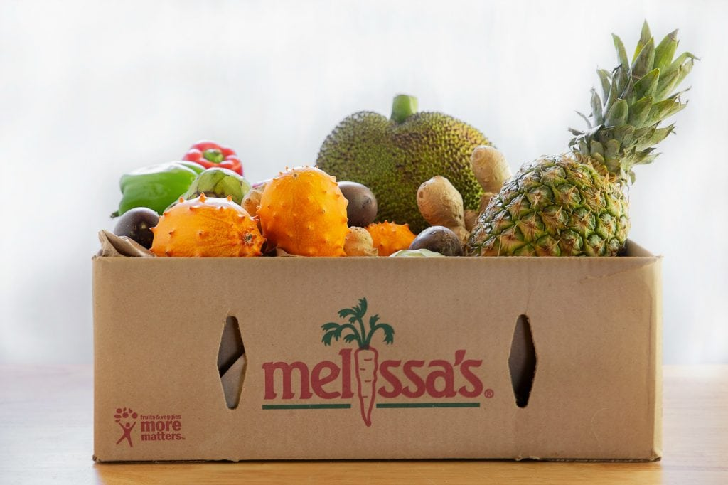 """cardboard crate filled with exotic fruits and priinted with """"melissa's Produce"""""""
