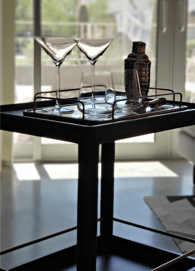 Bar cart with martini glasses and shaker readied to roll out onto the garden terrace for Mountain Shadows Resort Scottsdale Hotel Review