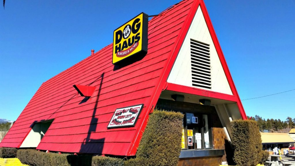 a-frame building with bright red roof and sign reading 'Dog Haus' is best place to eat in Flagstaff