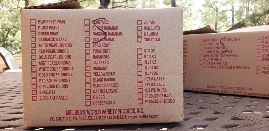 produce box printed with a list of exotic produce