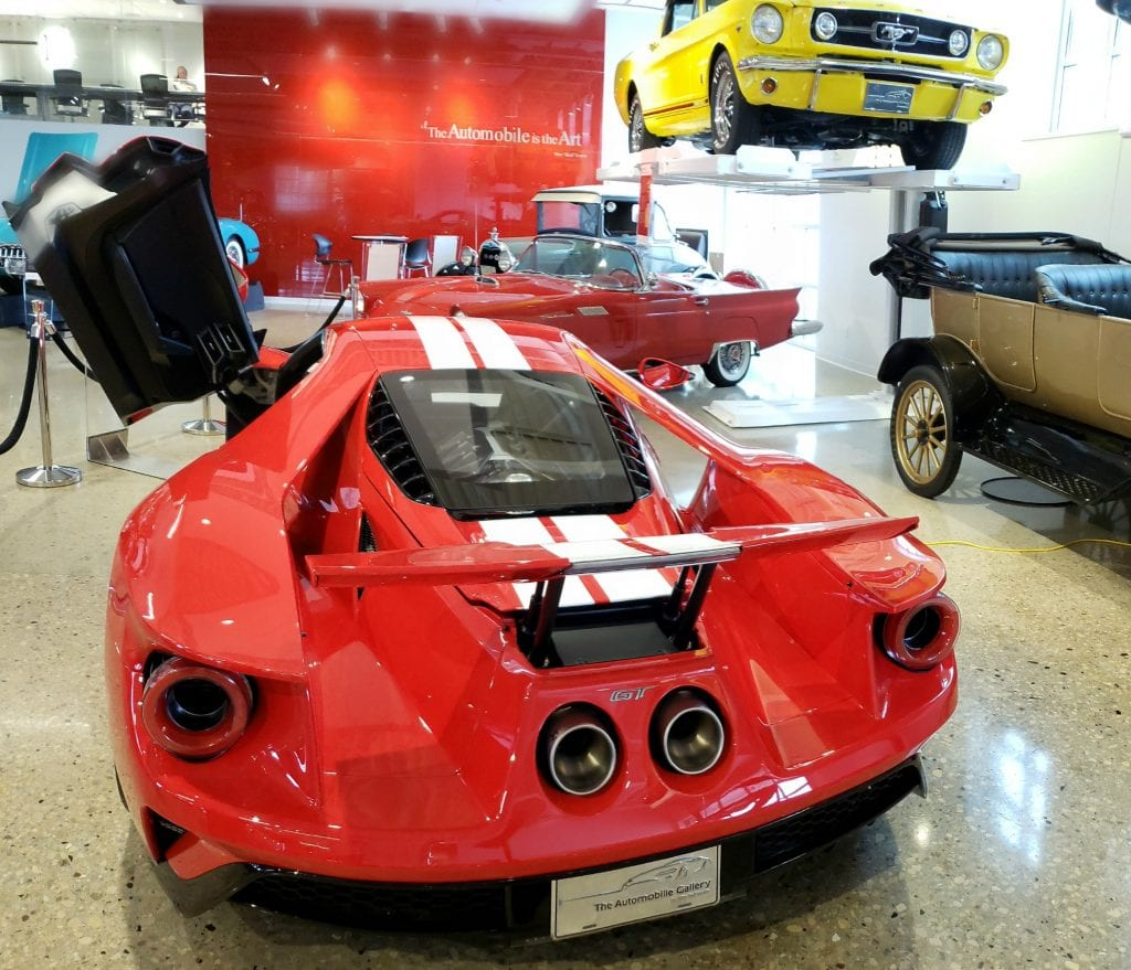 Flash red car that looks like a Maserati lifts it gull-wing doors at The Automobile Gallery, a Green Bay WI Attractions