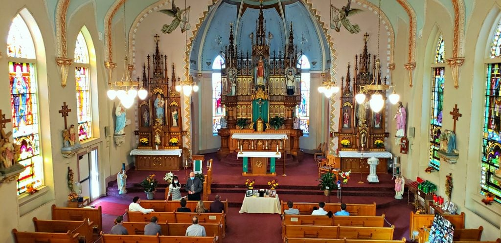 colorful sanctuary is decorated with stained glass, wall paintings and huge european style altar on the WI Way pilgrimage