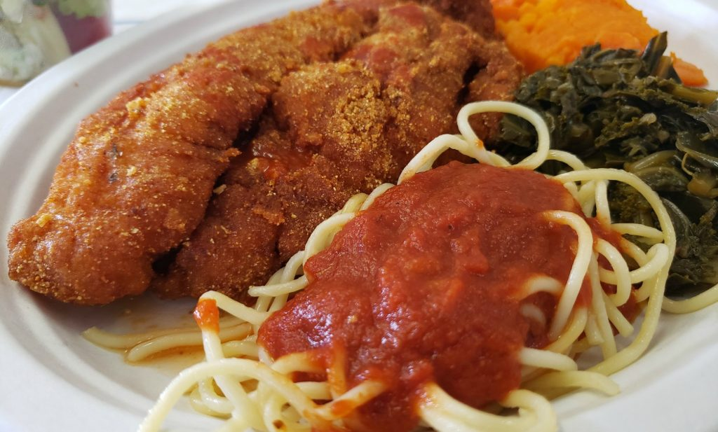 close up of plate with frie catfish, spaghetti with red sauce and greens and sweet potatoes (3 sides!)