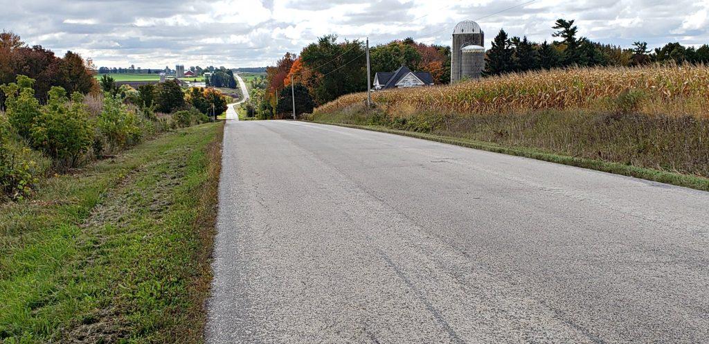 road winds over hills to distant horizona
