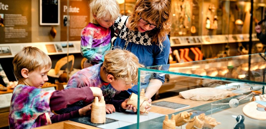 Mother with three young children seemed glued to display at Museum of Northern Arizona, one of fun things to do in Flagstaff