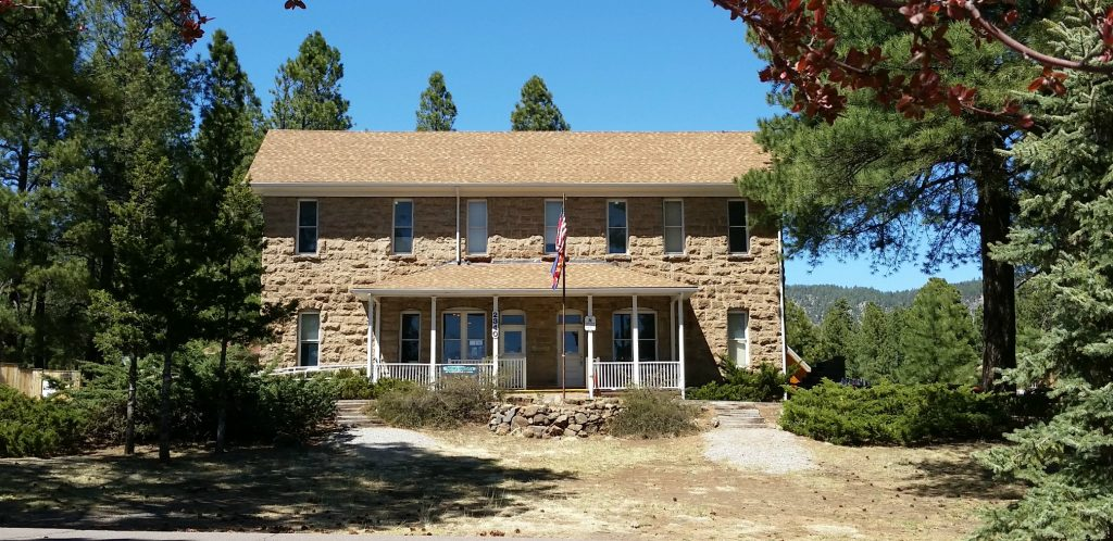 limestone 2-story building with porch and 7 windows on second floor is a thing to see in Flagstaff