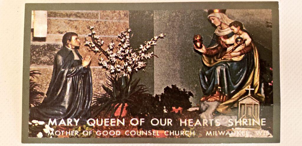 statue of St Louis de montford kneeling near statue of Mary holding Jesus
