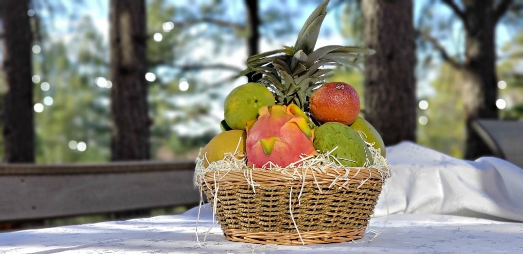 exotic fruit box unwrapped - fruit is arranges in a woven basket