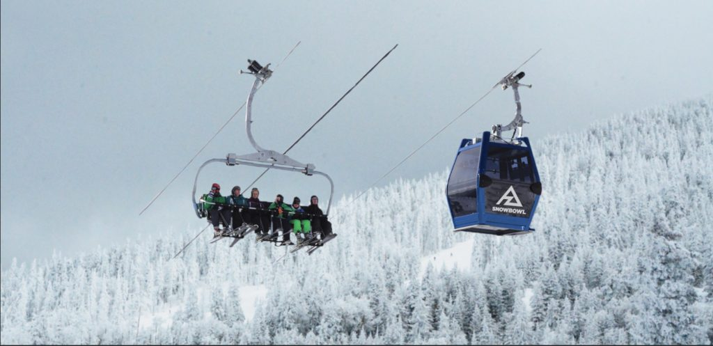 Another means of travel Flagstaff - gondola and chairlift above snow covered trees