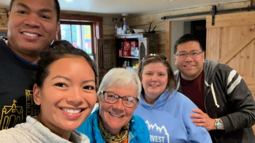 5 people smile for a selfie in the Paluso Guest Ranch kitchen on the WI oilgrimage